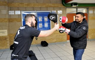 Two men sparing at Ebbsfleet Community Event