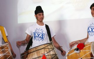 Boy playing drums at Ebbsfleet Community Event