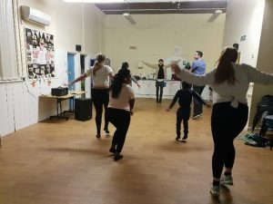 young people dancing in a hall
