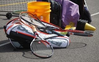 Pile of tennis equipment