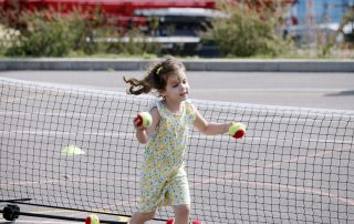 Girl playing with tennis balls
