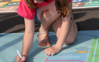 Girl drawing on floor