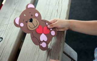 hand holding bear card