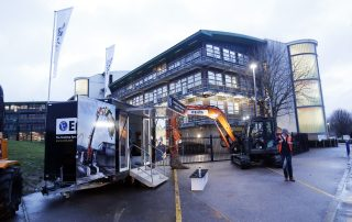 Digger parked outside building at the Ebbsfleet Jobs Fair