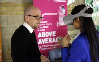 Girl using virtual reality mask at the Ebbsfleet Jobs Fair