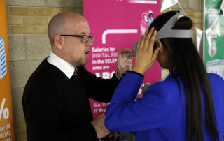 Back of girl using virtual reality mask at the Ebbsfleet Jobs Fair