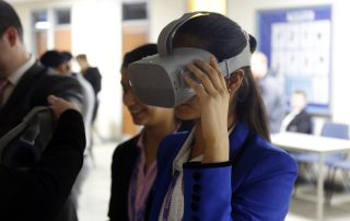 Woman using virtual reality googles at the Ebbsfleet Jobs Fair