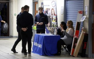 People talking art stand at the Ebbsfleet Jobs Fair