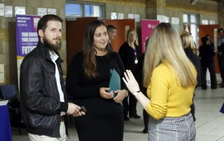 Man and two women talking at the Ebbsfleet Jobs Fair
