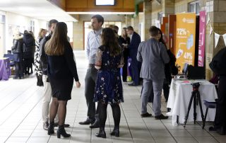 people talking at job trade fair