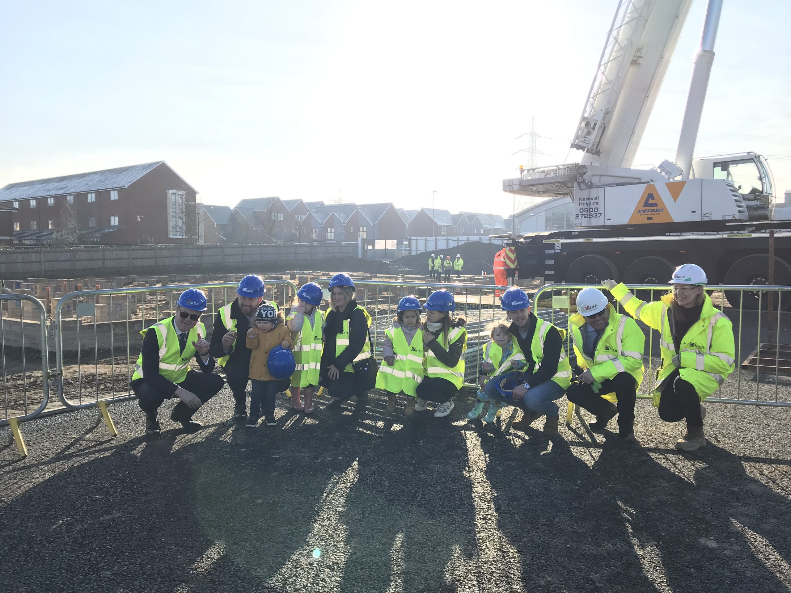 A group of people near a crane