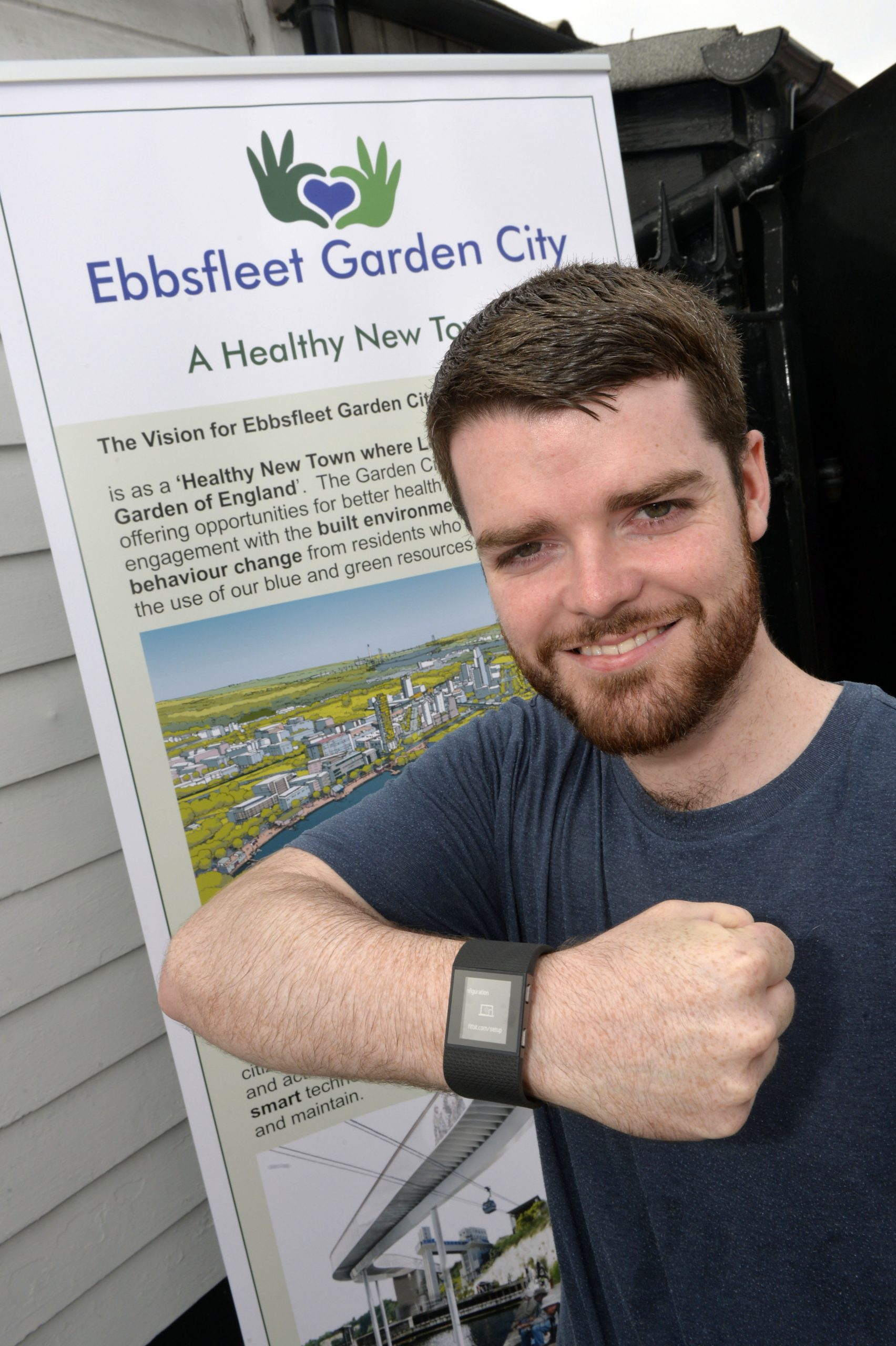 A man with a fitbit watch