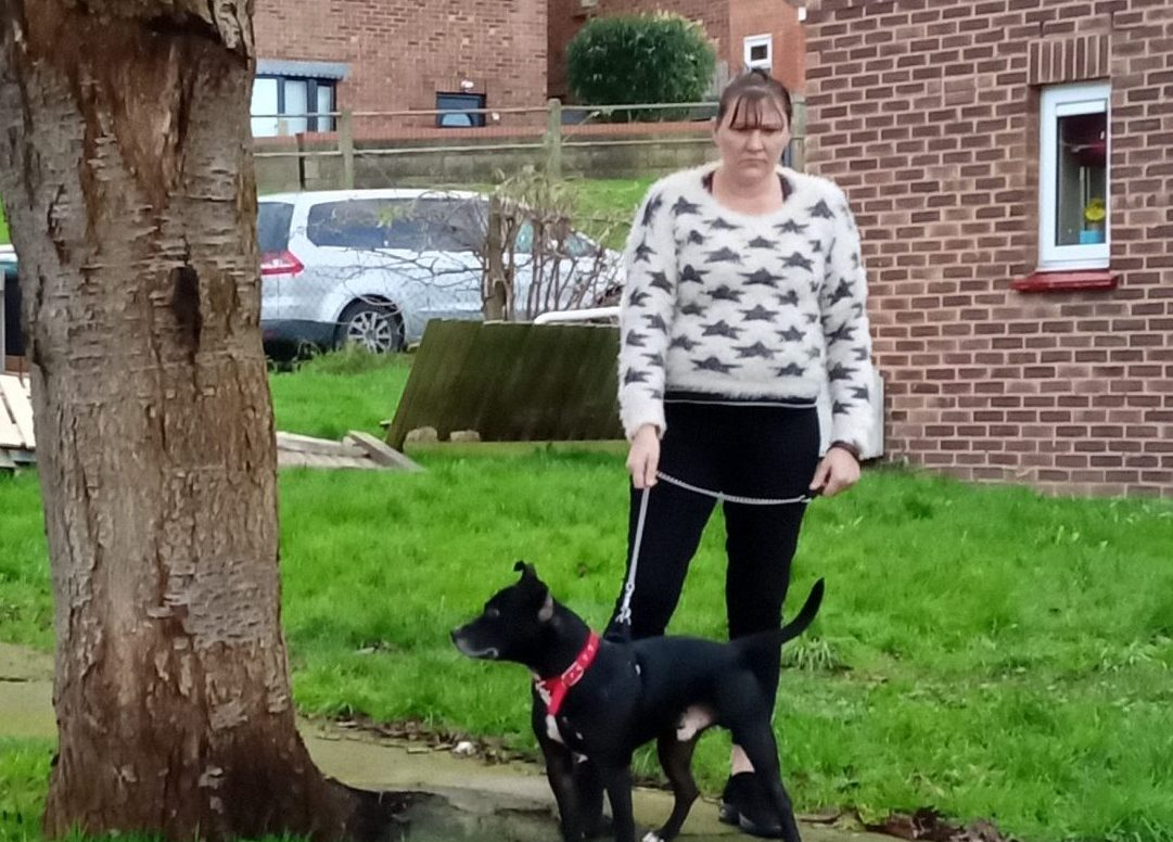A picture showing Aileen and her dog
