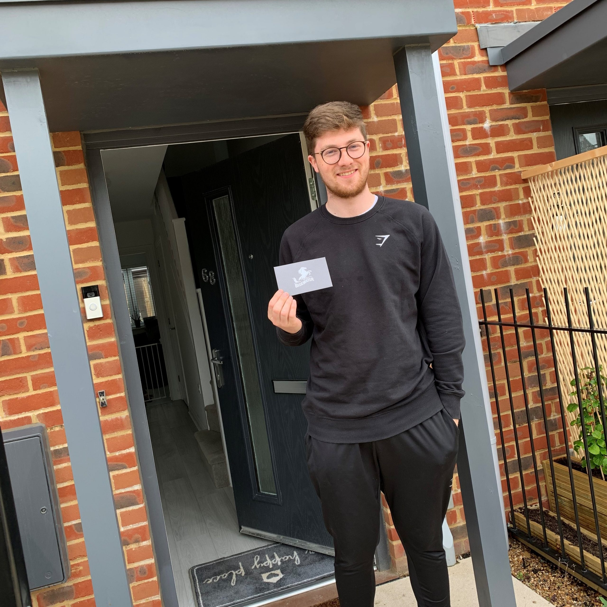 Luke Cross winner of our prize draw standing in front of front door