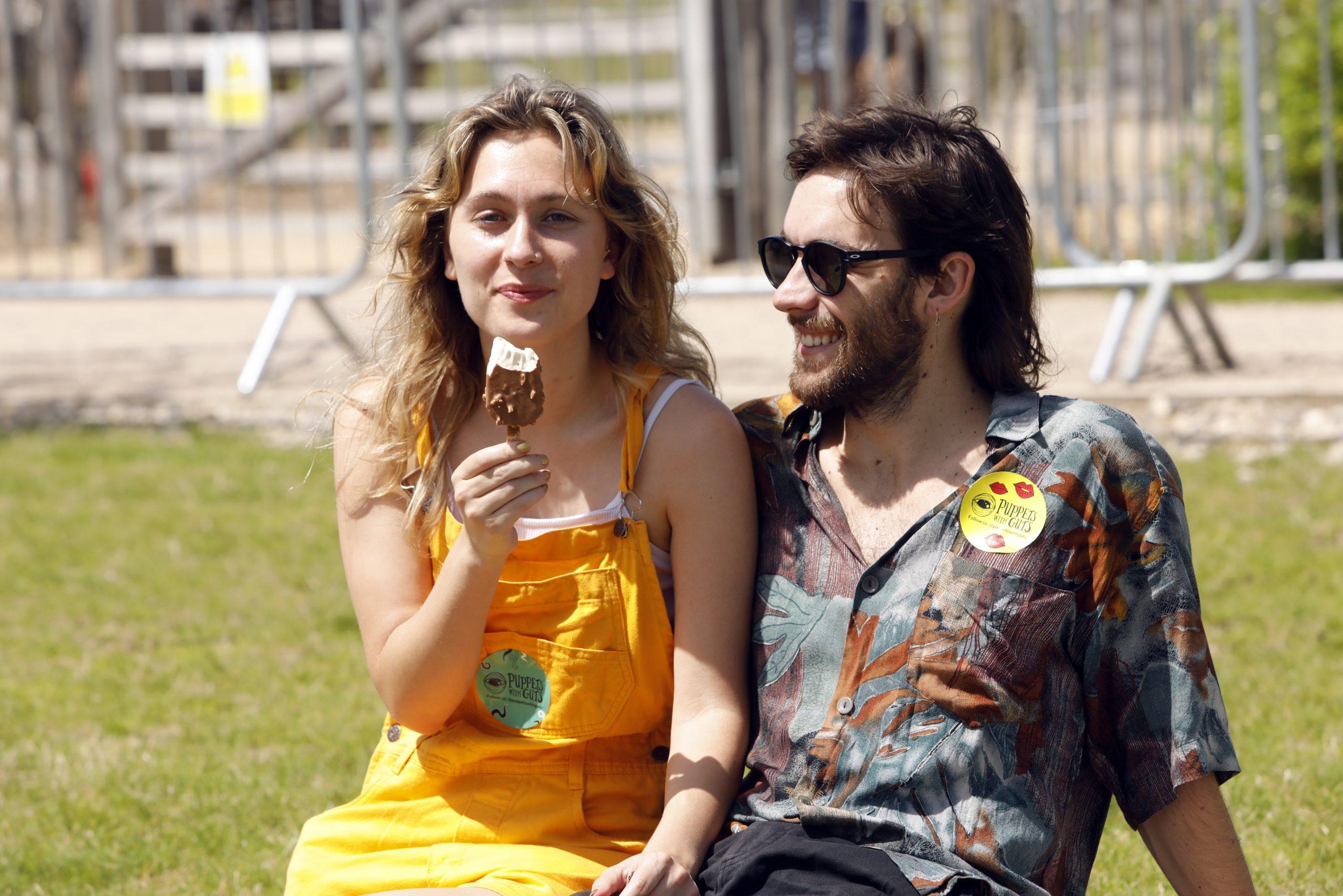A couple eat an ice cream