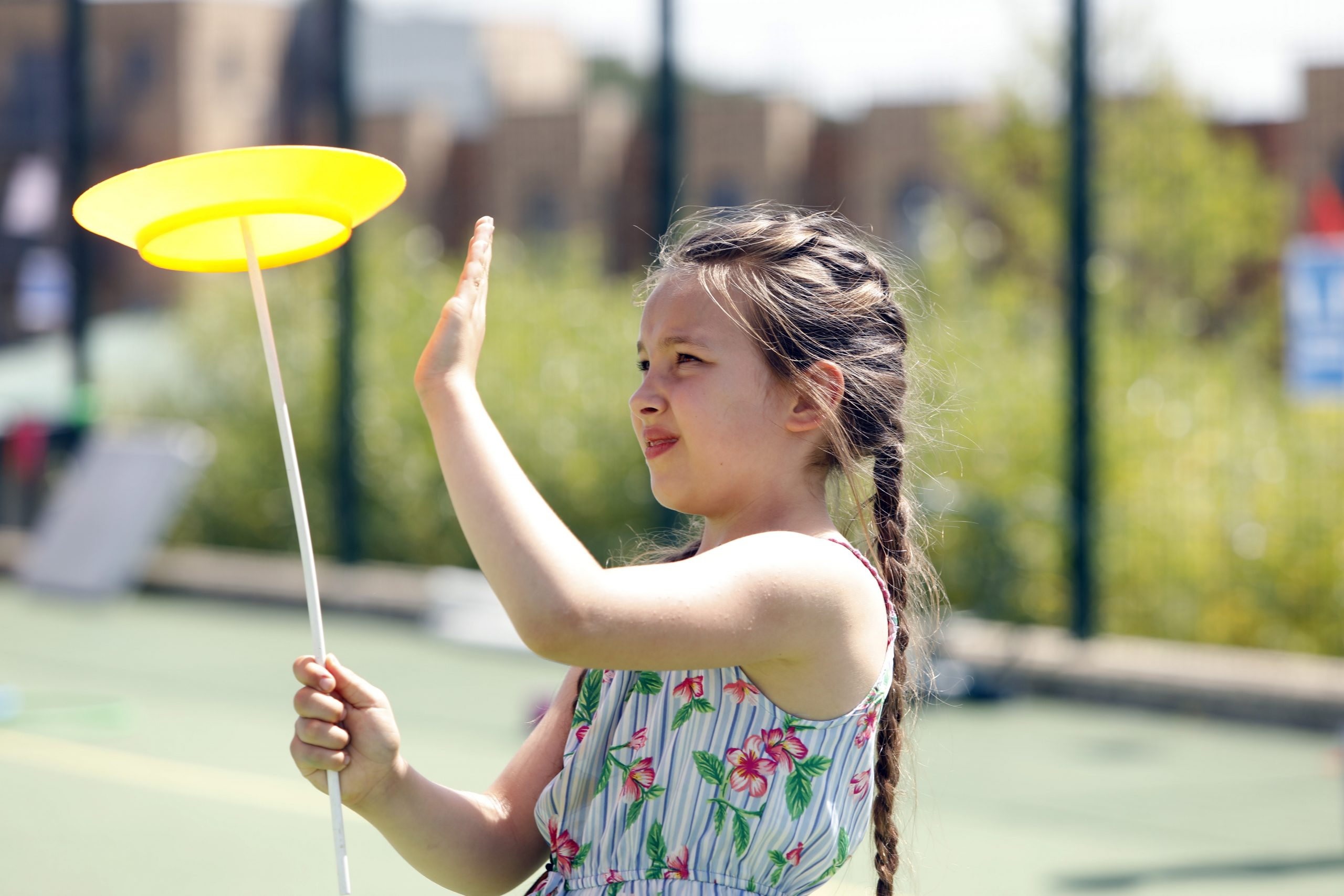 A girl spins a plate